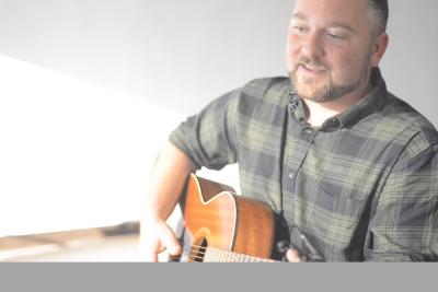 James playing guitar